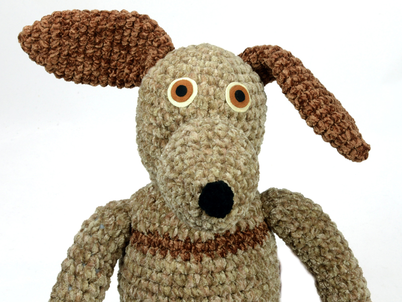 Handmade crocheted striped dog.