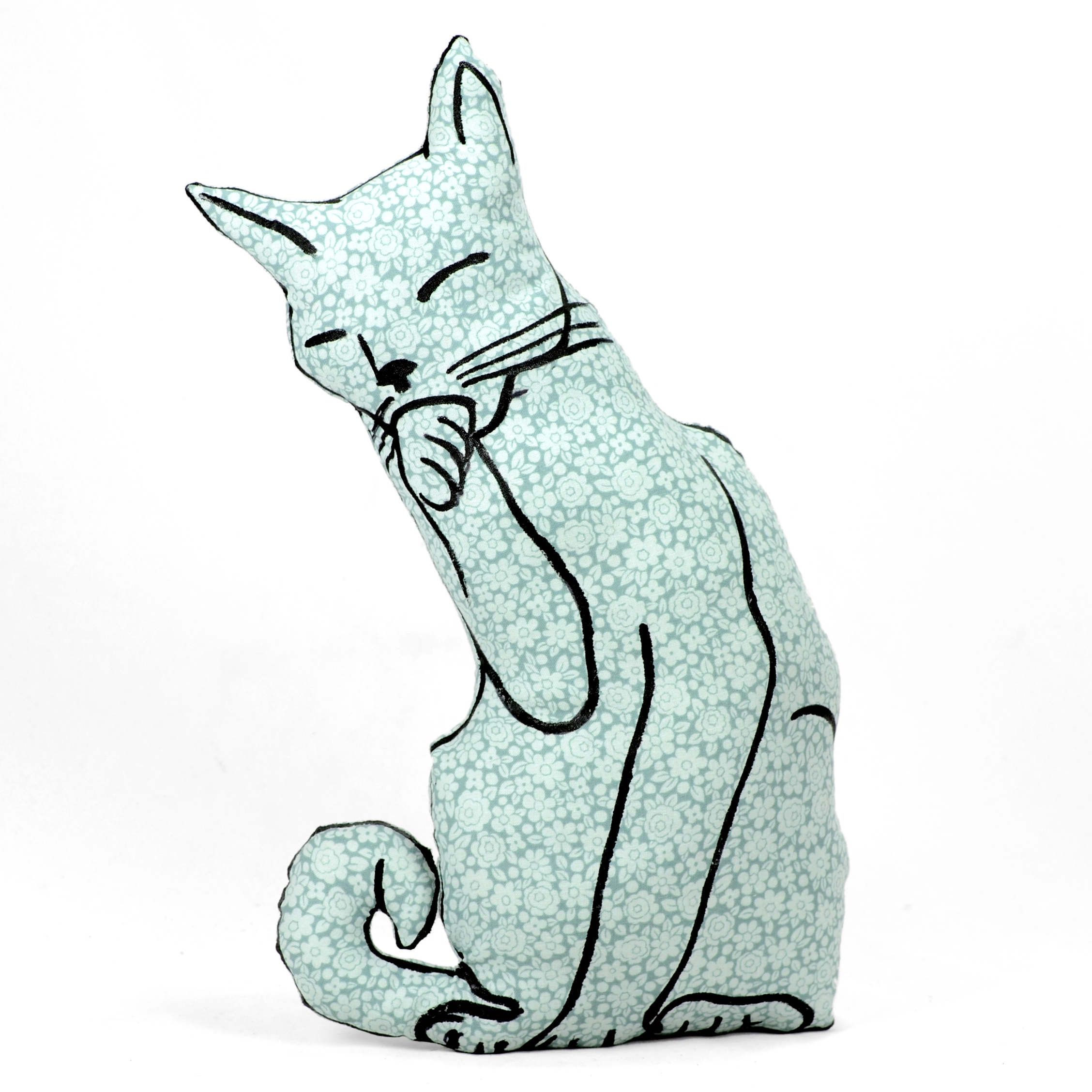 Hand drawn cat licking paw shaped pillow.